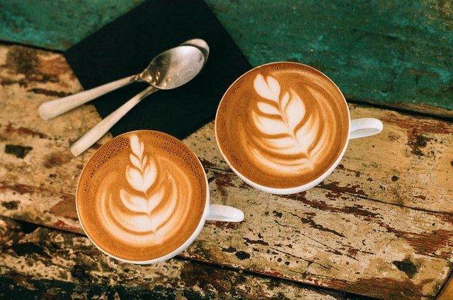 two flat white coffees