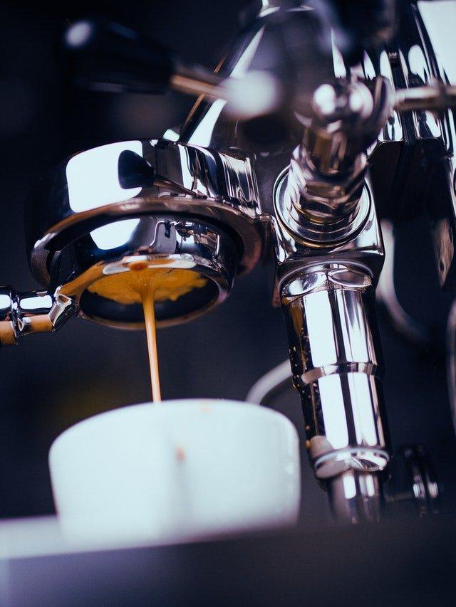 espresso machine extracting coffee