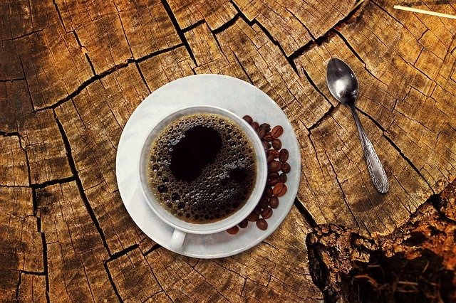 coffee on wood log